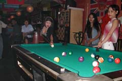 Girls playing pool in a Batam bar